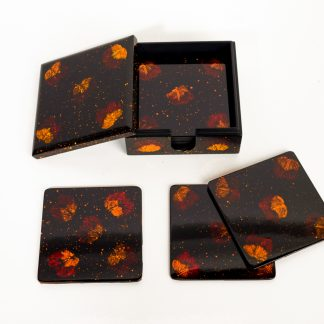 Set of eight pressed flower wooden lacquer coasters in matching lacquer box.