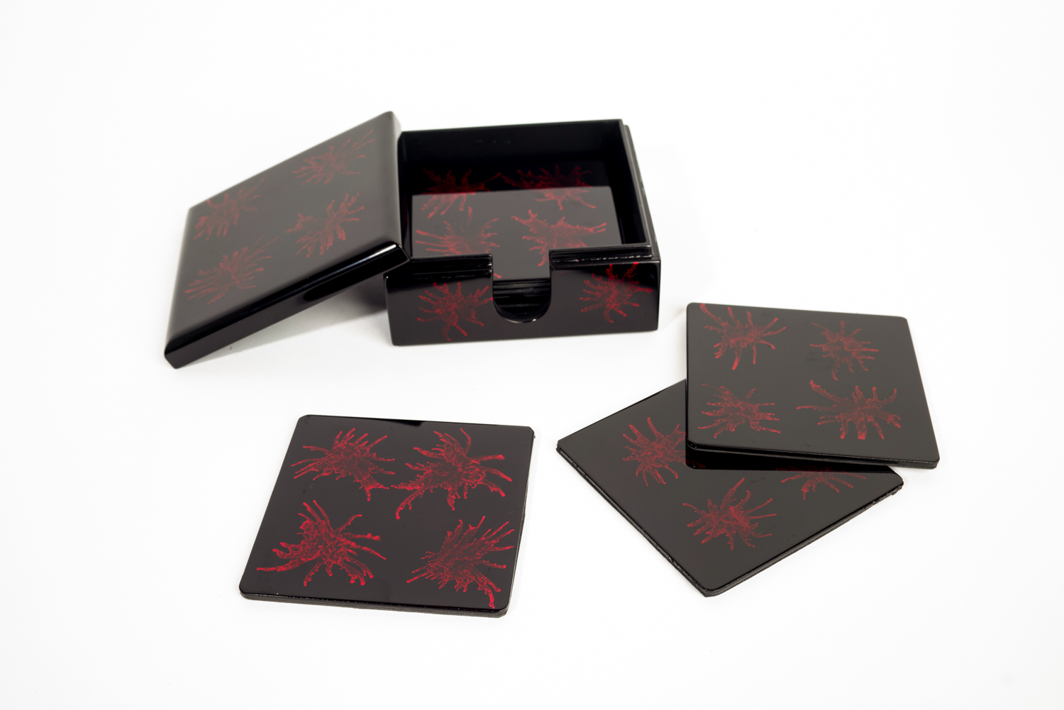 Red and black splash wooden lacquer coaster set with matching box.