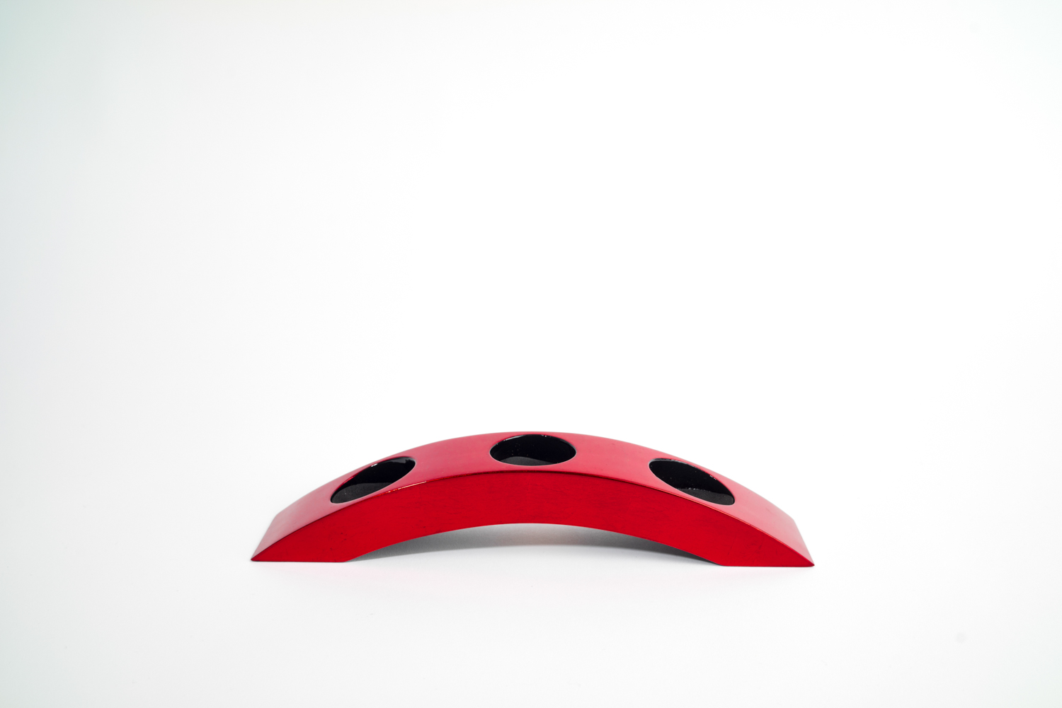 Metallic red wooden lacquer tealight holder in bridge 3 design.