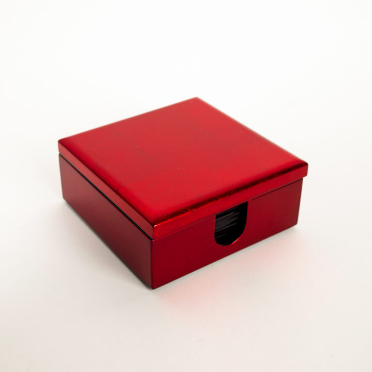 Red metallic wooden lacquer box containing eight matching wooden lacquer coasters.