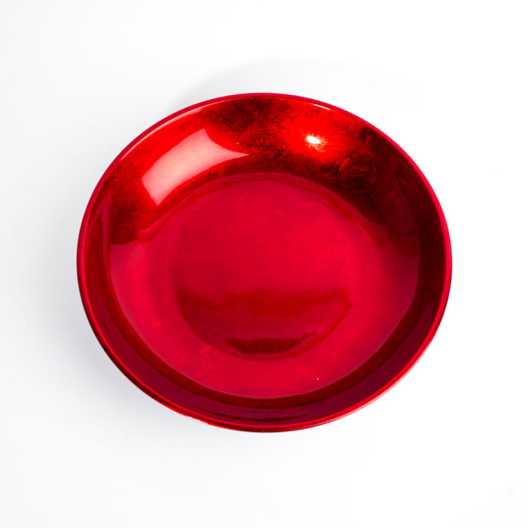 Metallic red wooden lacquer bowl.