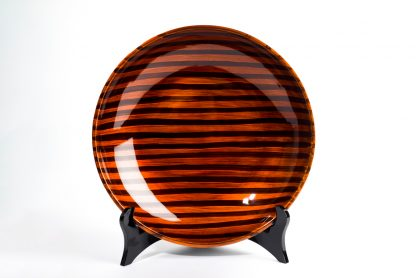 Tiger's Eye wooden lacquer serving bowl on black wooden lacquer plate stand.