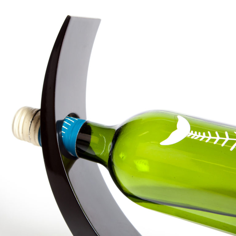Close up of neck of black wooden lacquer wine holder with bottle of wine