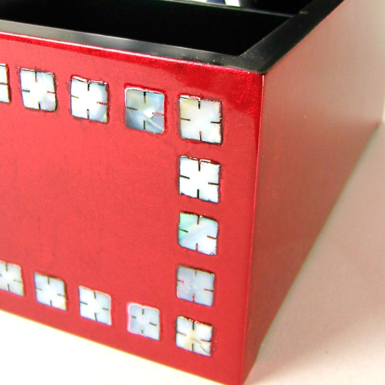Metallic red wooden lacquer remote control box close up of Mother of Pearl inlay